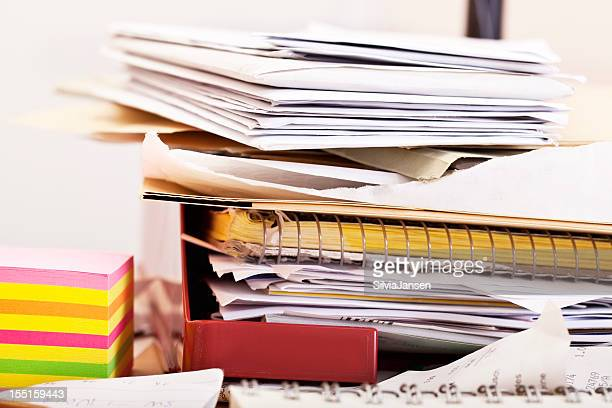 stack of files and papers