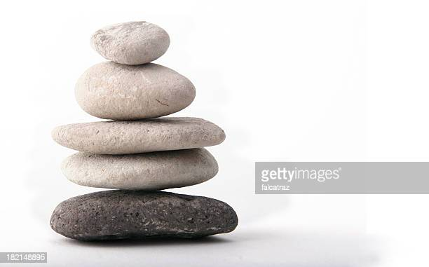 A stack of flat rocks on a white background