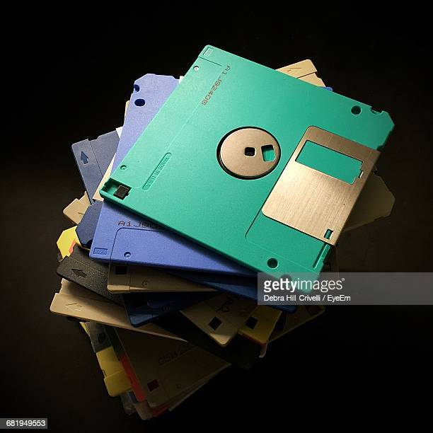 Stack Of Floppy Disks Against Black Background