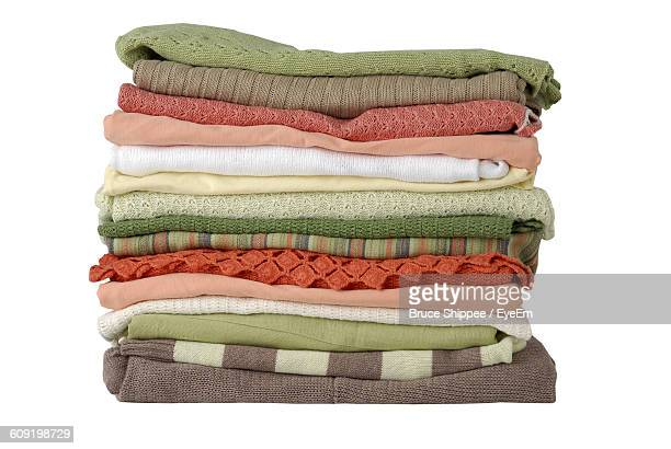 Stack Of Folded Clothes Over White Background