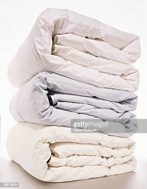 Stack of folded comforters