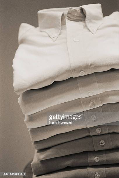 Stack of folded shirts (brown toned)