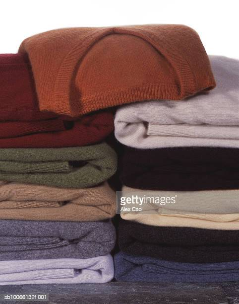stack of folded sweaters - cashmere stock pictures, royalty-free photos & images