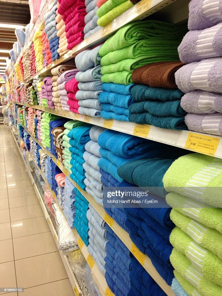 Stack Of Folded Towels On Shelf In Shopping Mall Stock Photo | Getty ...