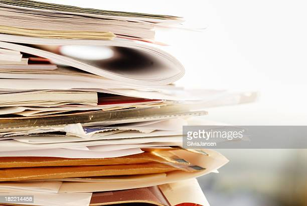 stack of folders, papers and envelops