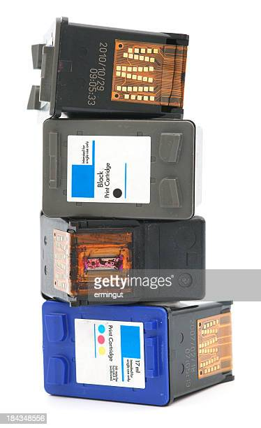 Stack of four ink cartridges on white background