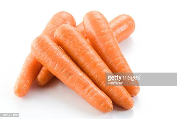 stack of fresh clean carrots isolated on white background - carrot stock pictures, royalty-free photos & images