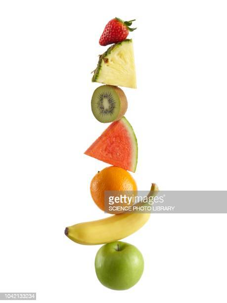 stack of fresh fruit - tropical fruit stock pictures, royalty-free photos & images
