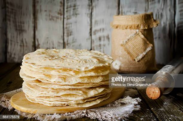 a stack of freshly made flour tortilla's - tortilla flatbread stock photos and pictures