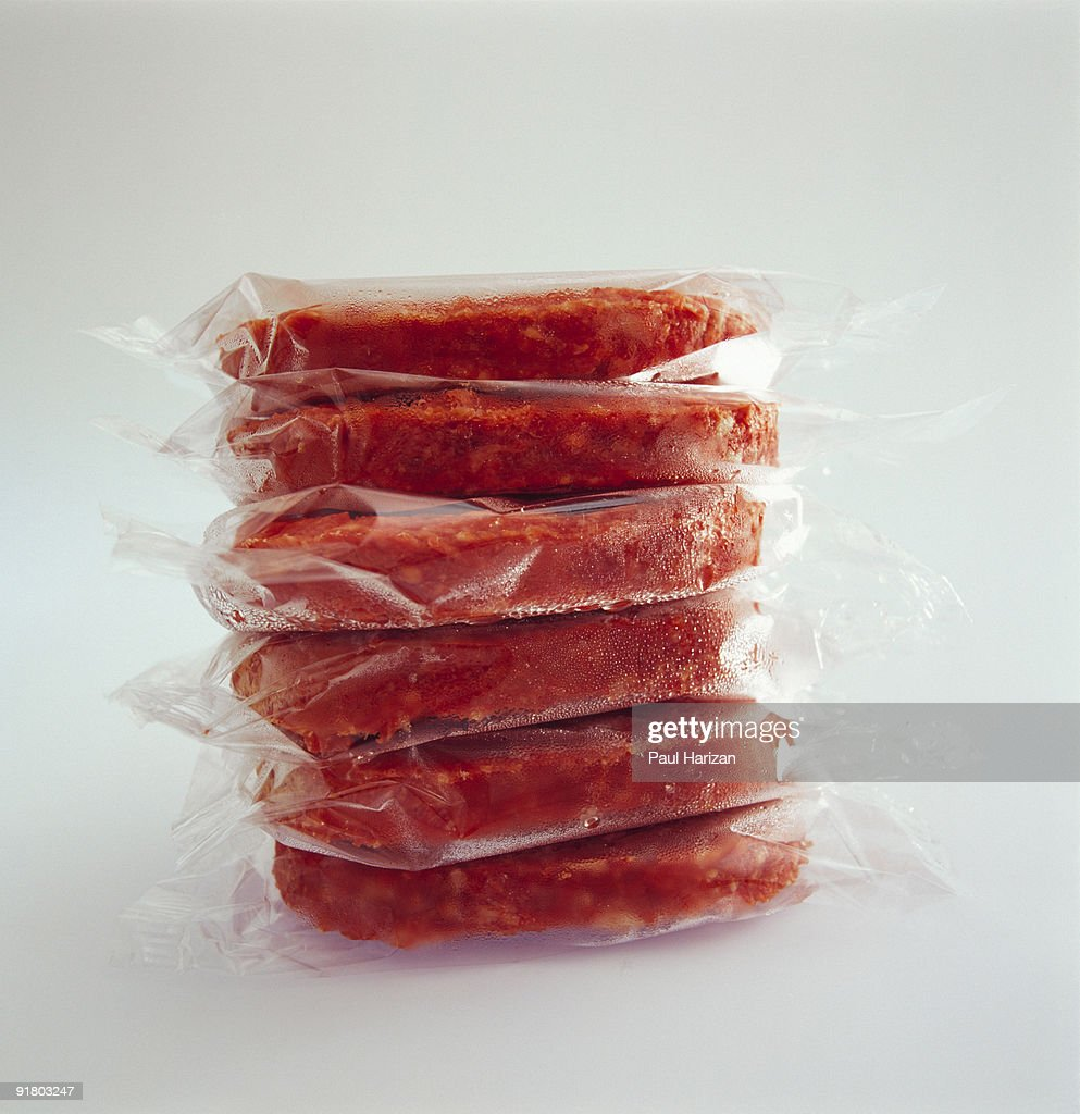 Stack of frozen meat : Stock Photo