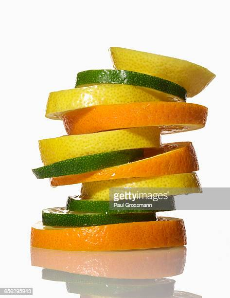 Stack of fruit on white background