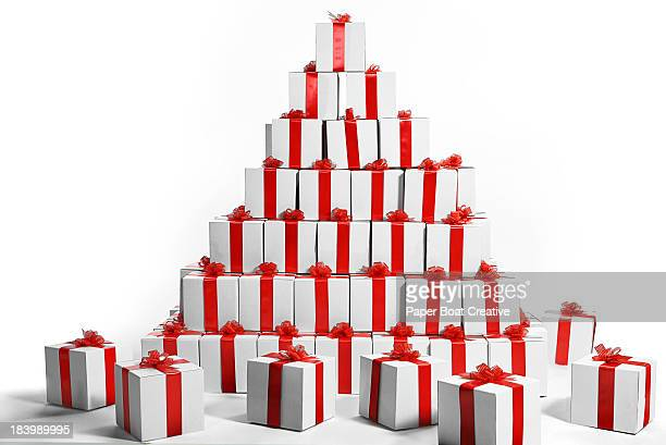 Stack of gift boxes wrapped with red ribbon