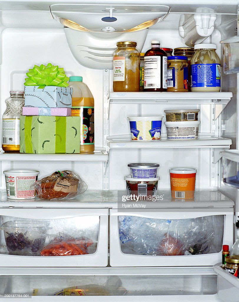 Stack of gifts inside refrigerator : Stock Photo