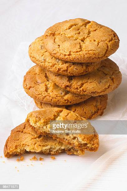 stack of ginger biscuits on a white background