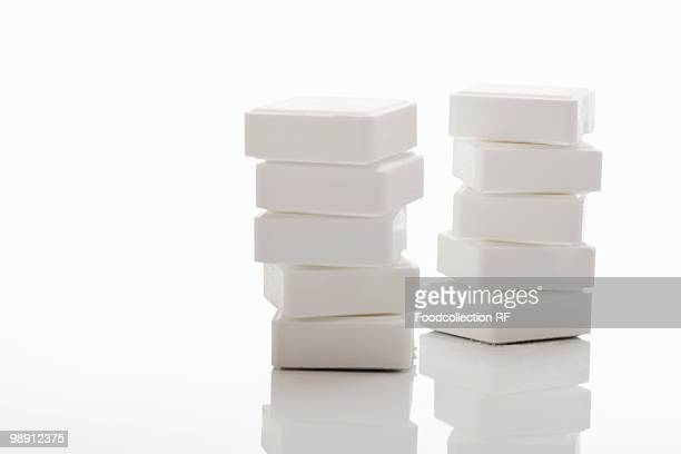 Stack of glucose tablets on white background