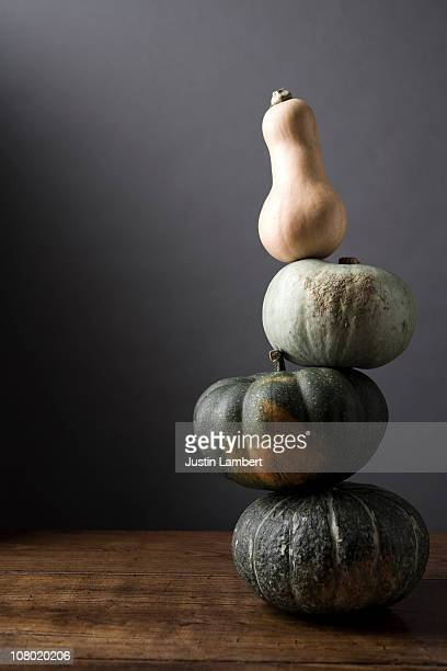 Stack of gourds on table