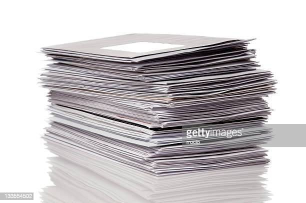 Stack of gray unopened mail reflected on white background