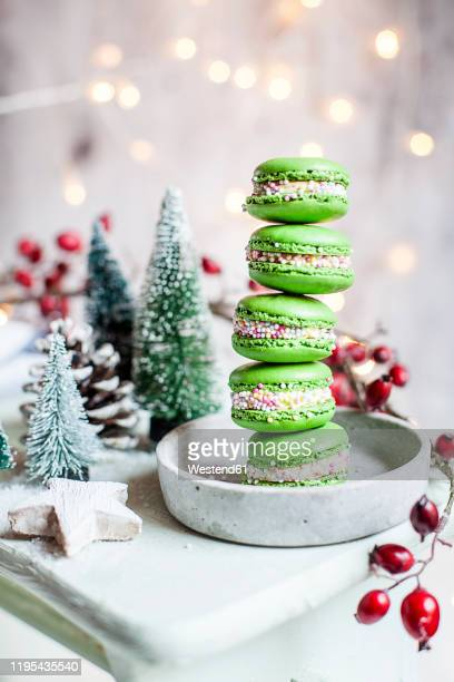 stack of green macaroons and christmas decorations - dessert stock pictures, royalty-free photos & images