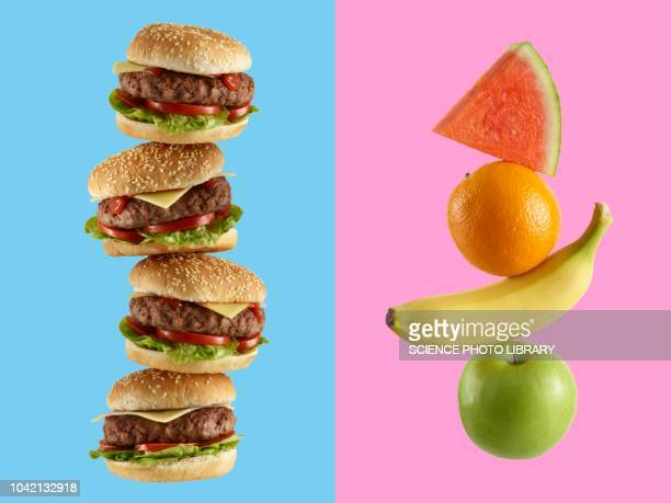 stack of hamburgers and stack of fruit - unhealthy eating stock pictures, royalty-free photos & images