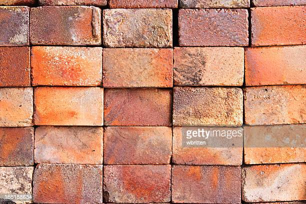 stack of hand crafted bricks for texture background - stack rock stock pictures, royalty-free photos & images