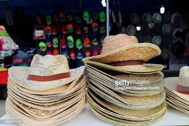 stack of hats for sale in market - aungsumol stock pictures, royalty-free photos & images