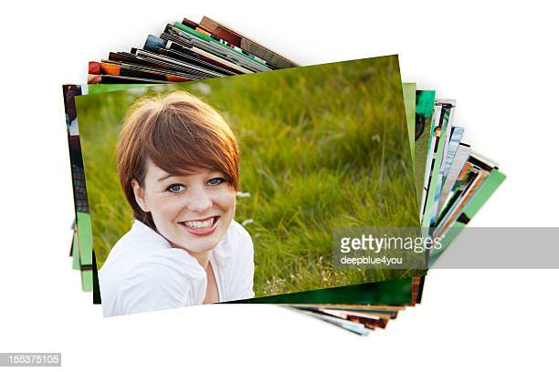 Stack of holiday photographs on white