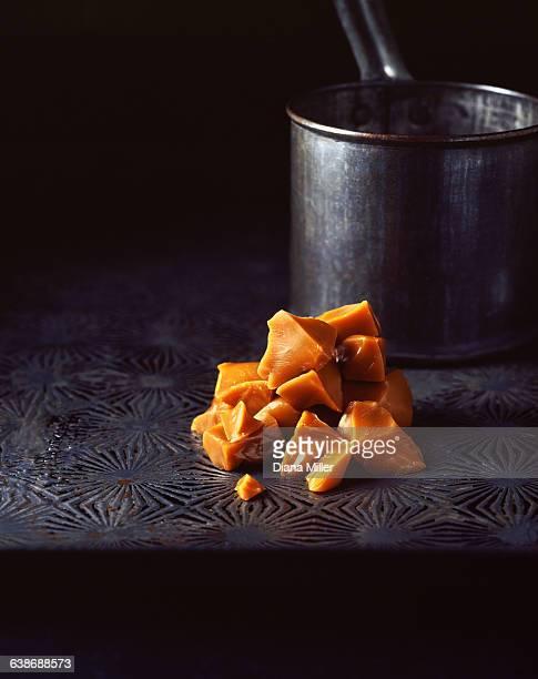 stack of home made toffee with metal saucepan - caramelo de manteiga comida doce imagens e fotografias de stock