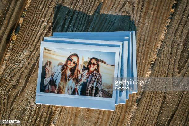 Stack of instant photos of two best friends