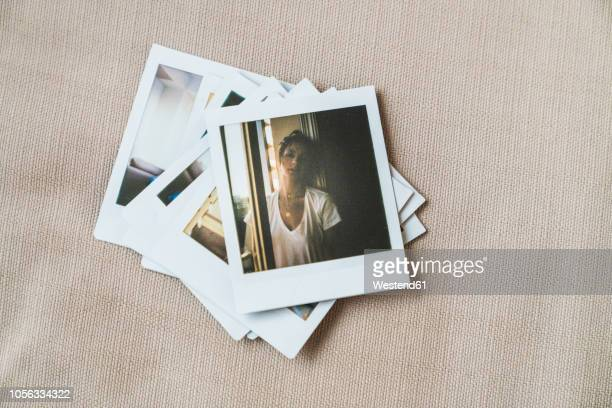 stack of instant photos of young woman - fotografie stock-fotos und bilder