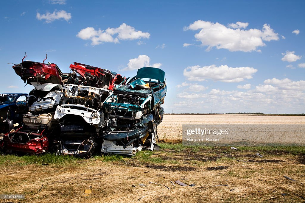 Stack Of Junked Cars Beside A Field Stock Photo | Getty Images