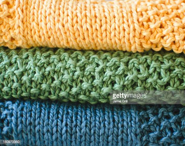 stack of knitted blankets - blanket stock pictures, royalty-free photos & images