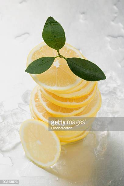stack of lemon slices, close up - lemon leaf stock photos and pictures