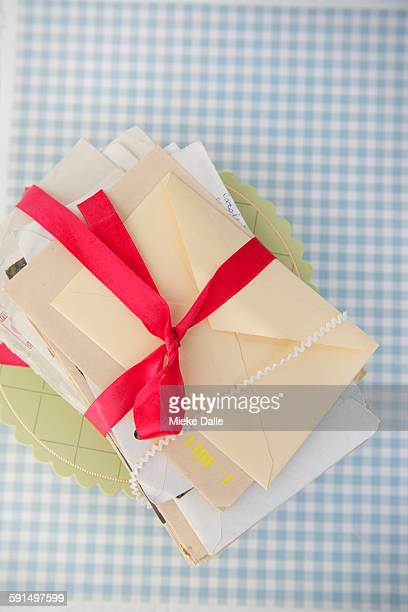 Stack of letters tied together with ribbon