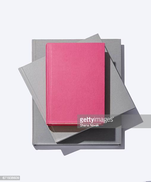stack of linen books - stack of books stock photos and pictures
