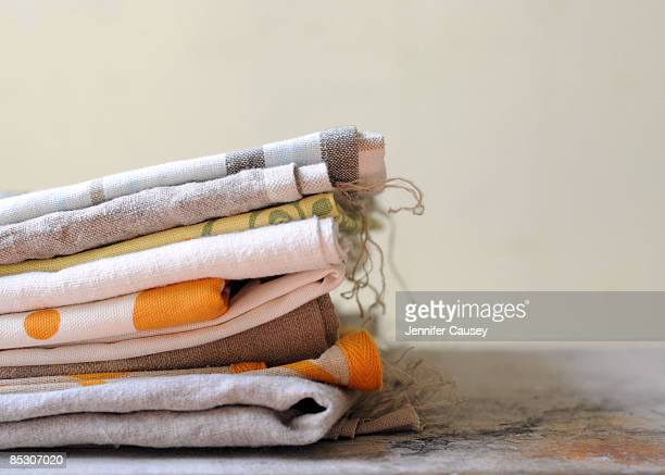 stack of linens - dish towel stock pictures, royalty-free photos & images