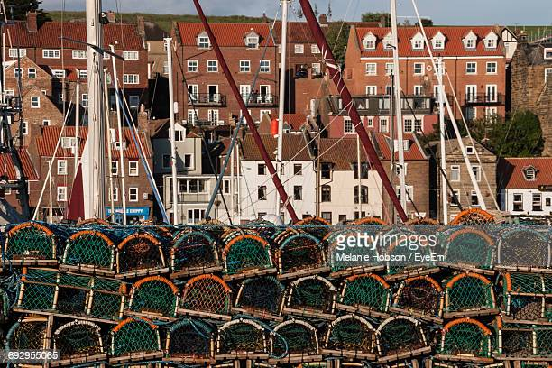 Stack Of Lobster Traps Against Buildings