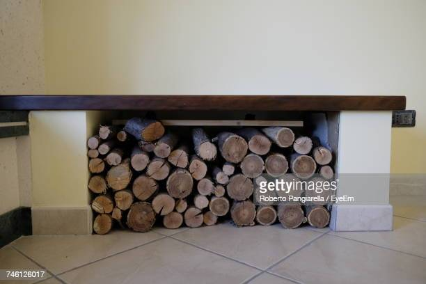 stack of logs in fireplace against wall - log stock pictures, royalty-free photos & images