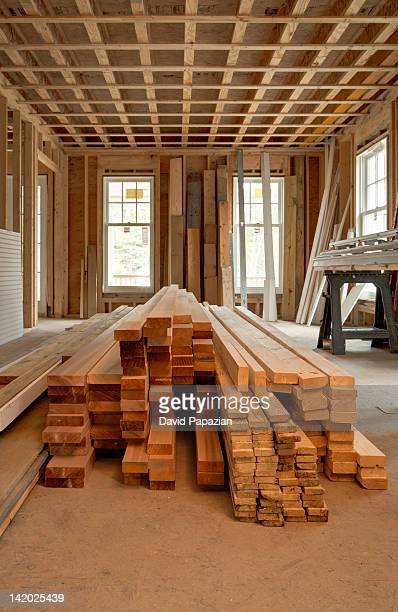 Stack of lumber inside of new home under construction