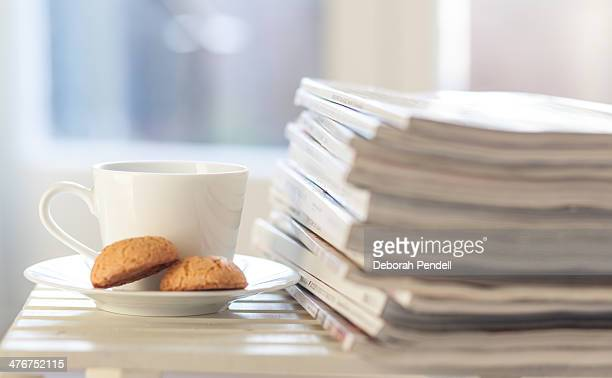 Stack of magazines and a cup of tea