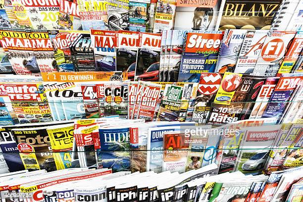 stack of magazines in a kiosk - mixed magazine stock photos and pictures