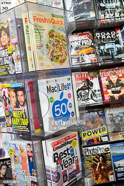 stack of magazines - magazine rack stock photos and pictures