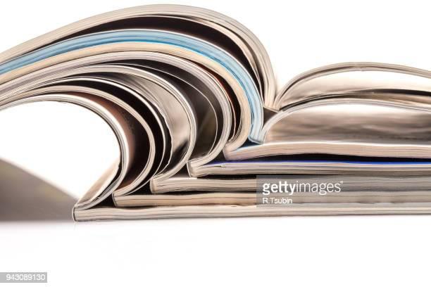 stack of magazines - advertising column stock-fotos und bilder