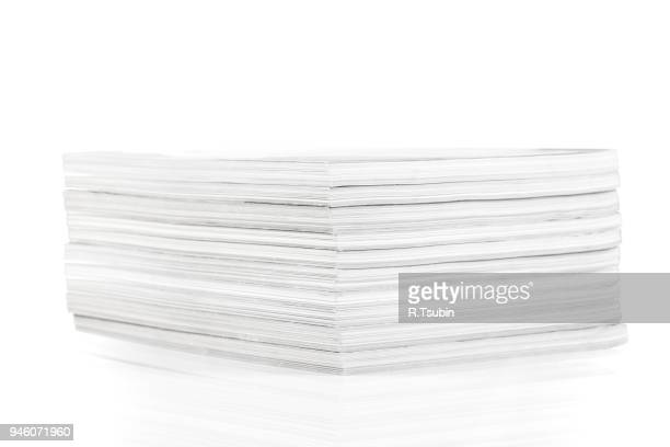 stack of magazines - magazine page stock photos and pictures