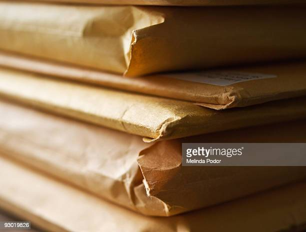 Stack of manila envelopes or packages