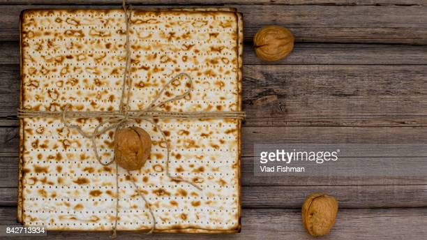 stack of matzah or matza on a vintage wood background presented as a gift - passover symbols stock pictures, royalty-free photos & images