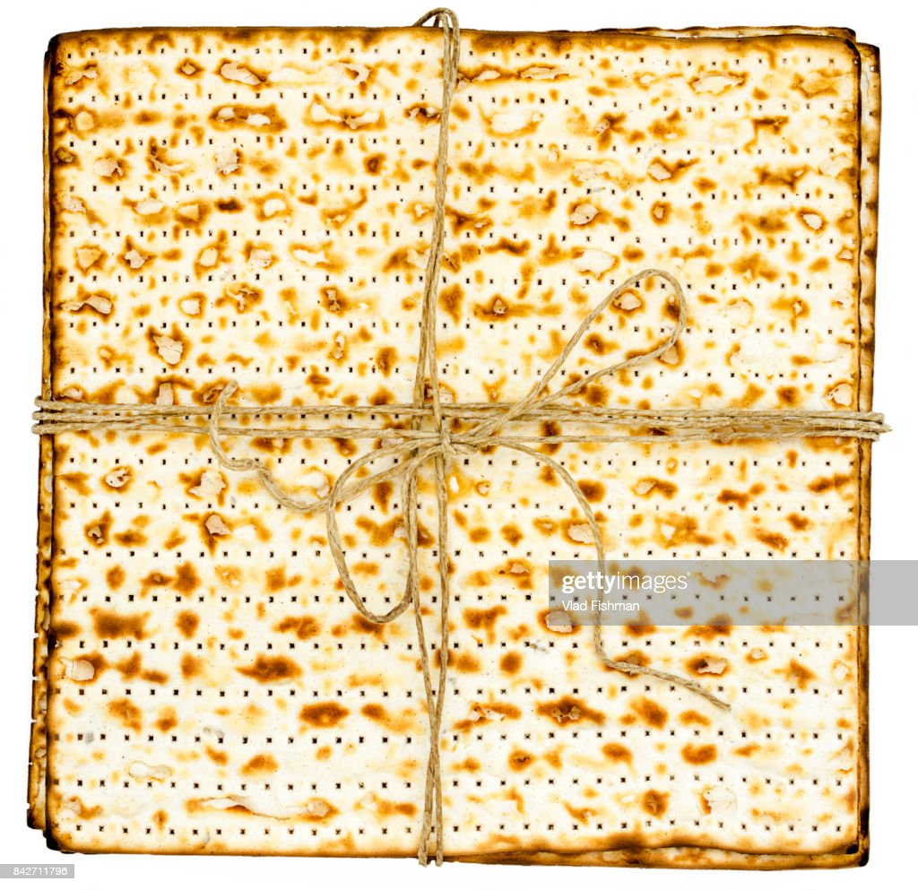 Stack of matzah or matza on white isolated background presented as a gift : Stock Photo
