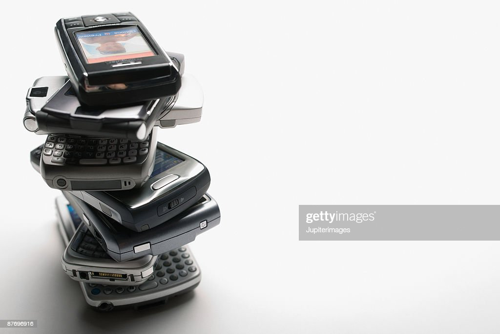 Stack of mobile telephones : Stock Photo