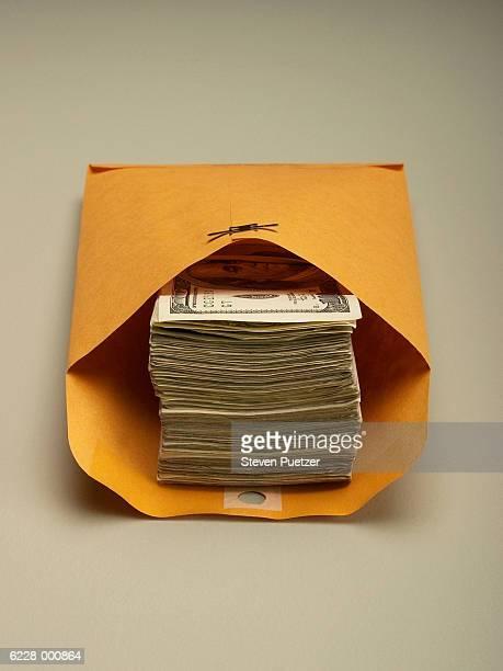 Stack of Money in Envelope