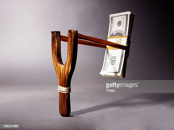 Stack of money in slingshot