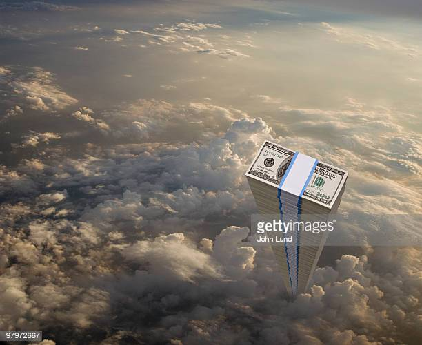 stack of money rising through the clouds - john lund stock pictures, royalty-free photos & images